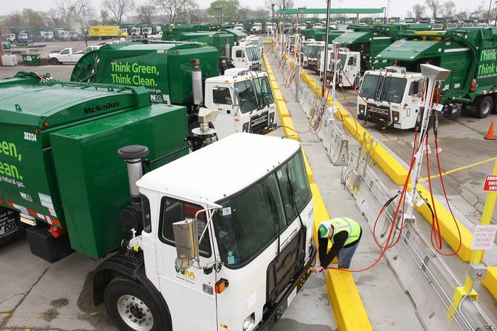 Waste management trucks refueling with CNG.