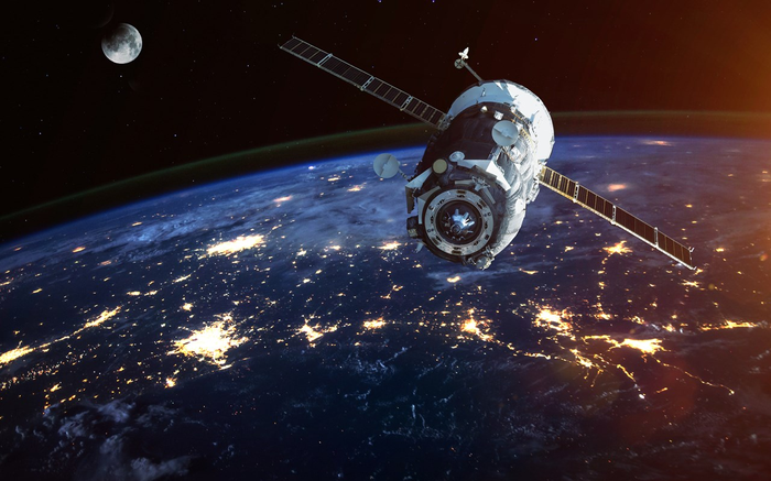 a satellite in orbit above the earth