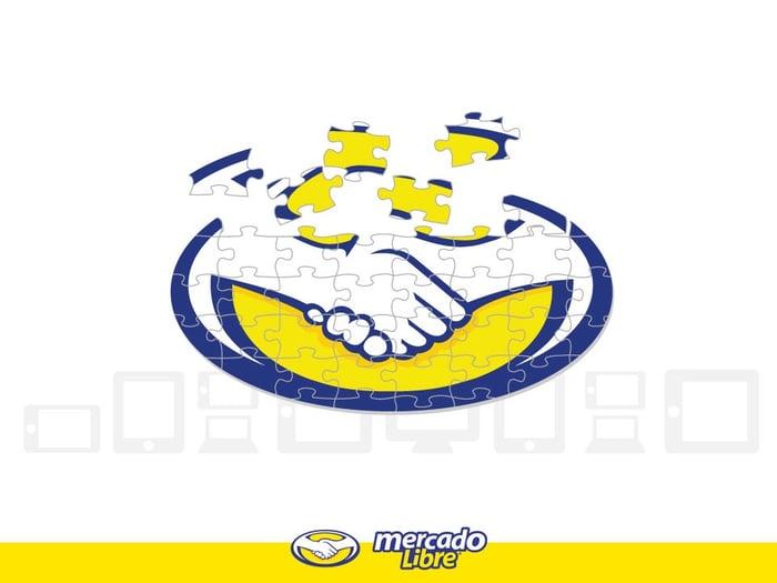 Mercadolibre's logo broken into jigsaw puzzle pieces.