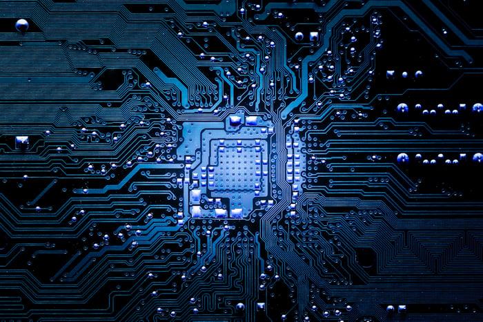 Dark blue microchip on motherboard.