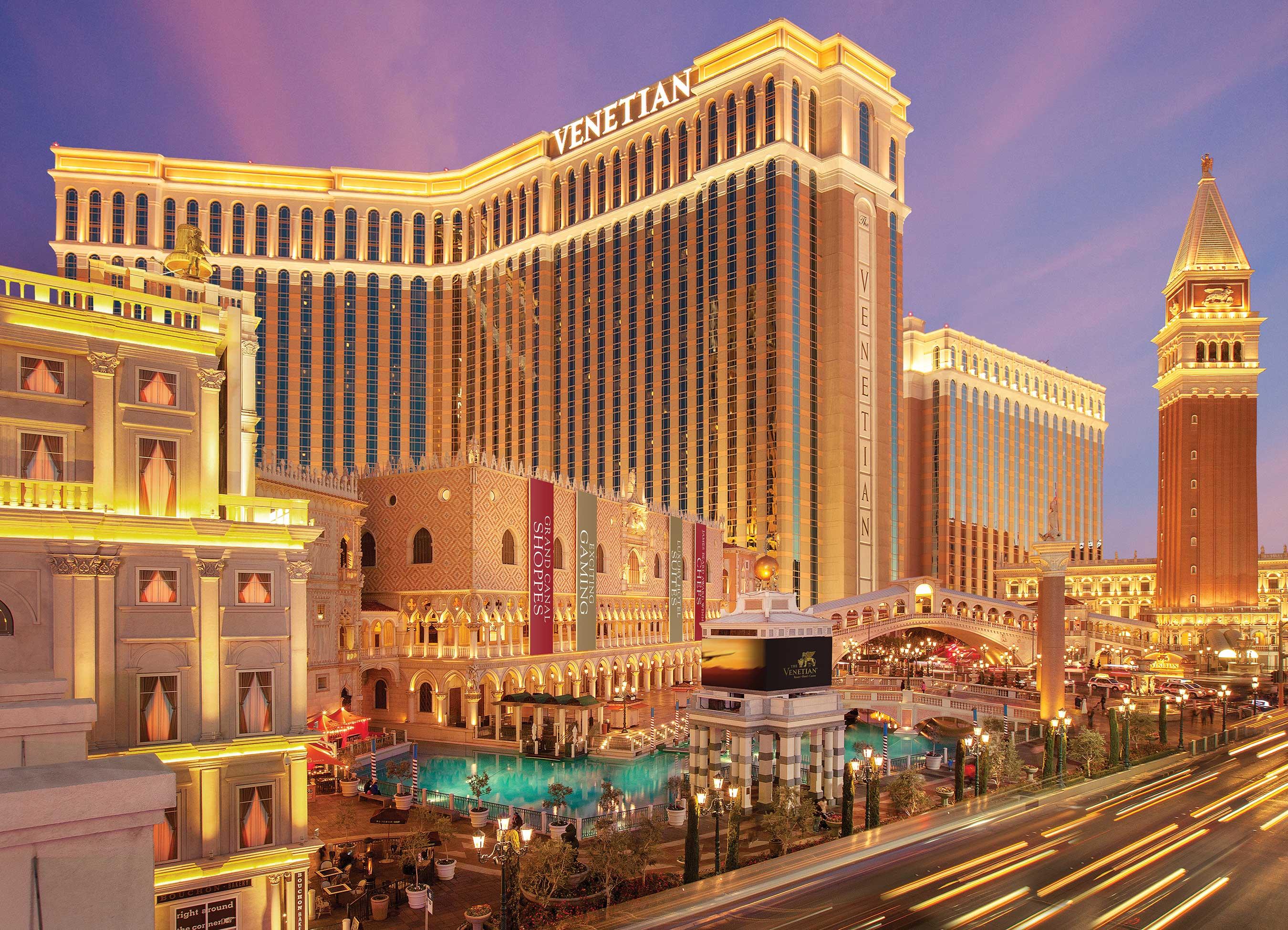 Venetian resort in Las Vegas, with streaks of cars on Strip going by.