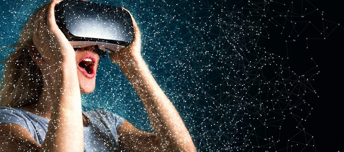 A woman wearing a VR headset surrounded by stars.