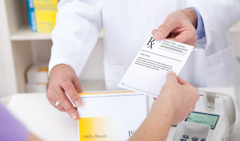 pharmacist with a prescription GettyImages-473445110