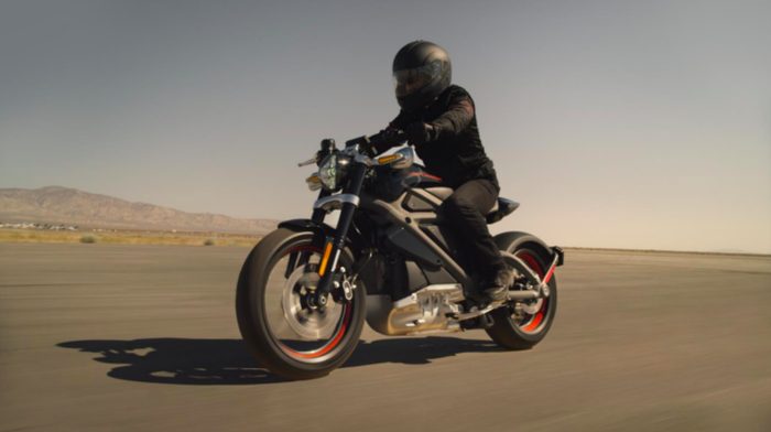 A person rides a Harley-Davidson Project LiveWire electric motorcycle