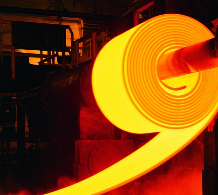 A hot roll of steel in a steel plant.