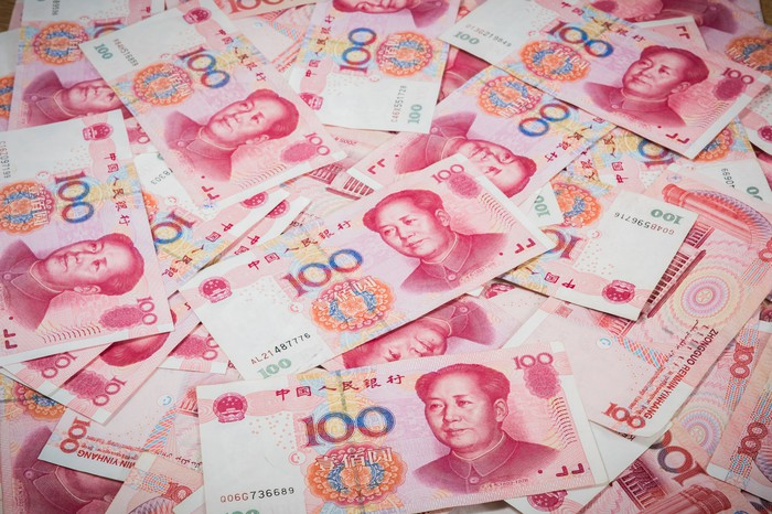 Chinese Yuan bills completely covering a flat surface