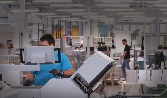 Workers using Cimpress' mass customization platform