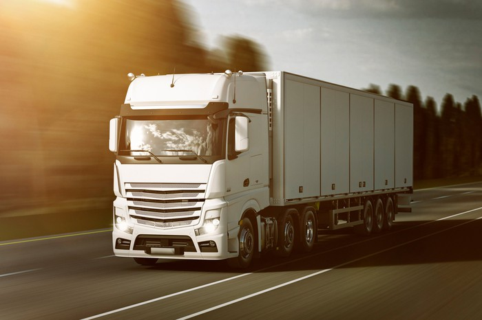 Long-haul refrigeration truck on the road.