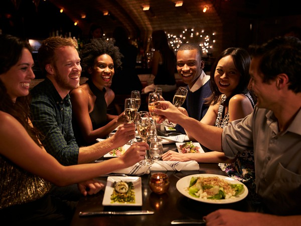 restaurant dining out eating friends party drinking toast getty