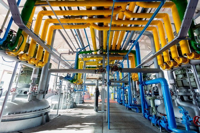 A series of pipes in a petrochemical manufacturing facility.