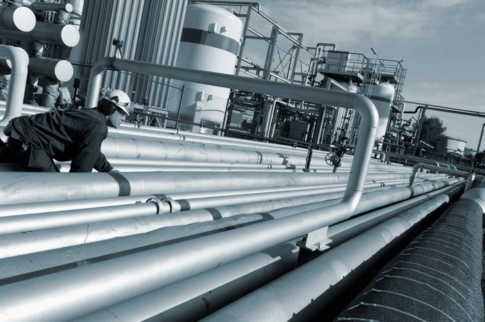 Person inspecting oil & gas pipelines.