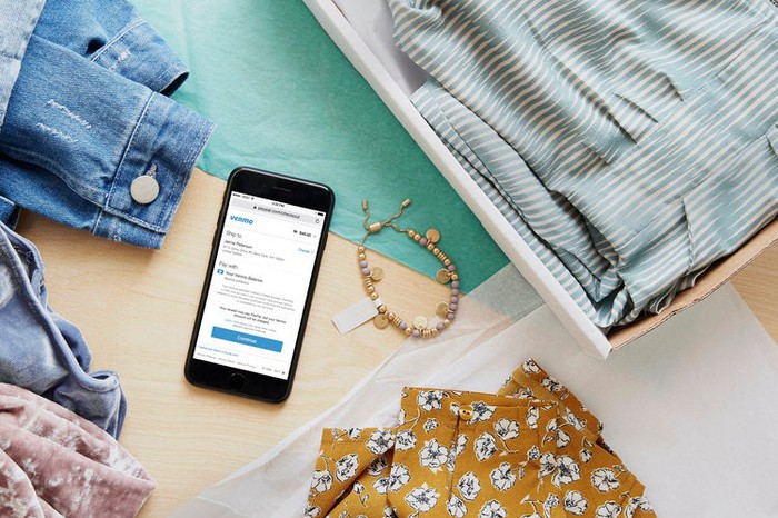 A mobile phone using Venmo Checkout to buy apparel.