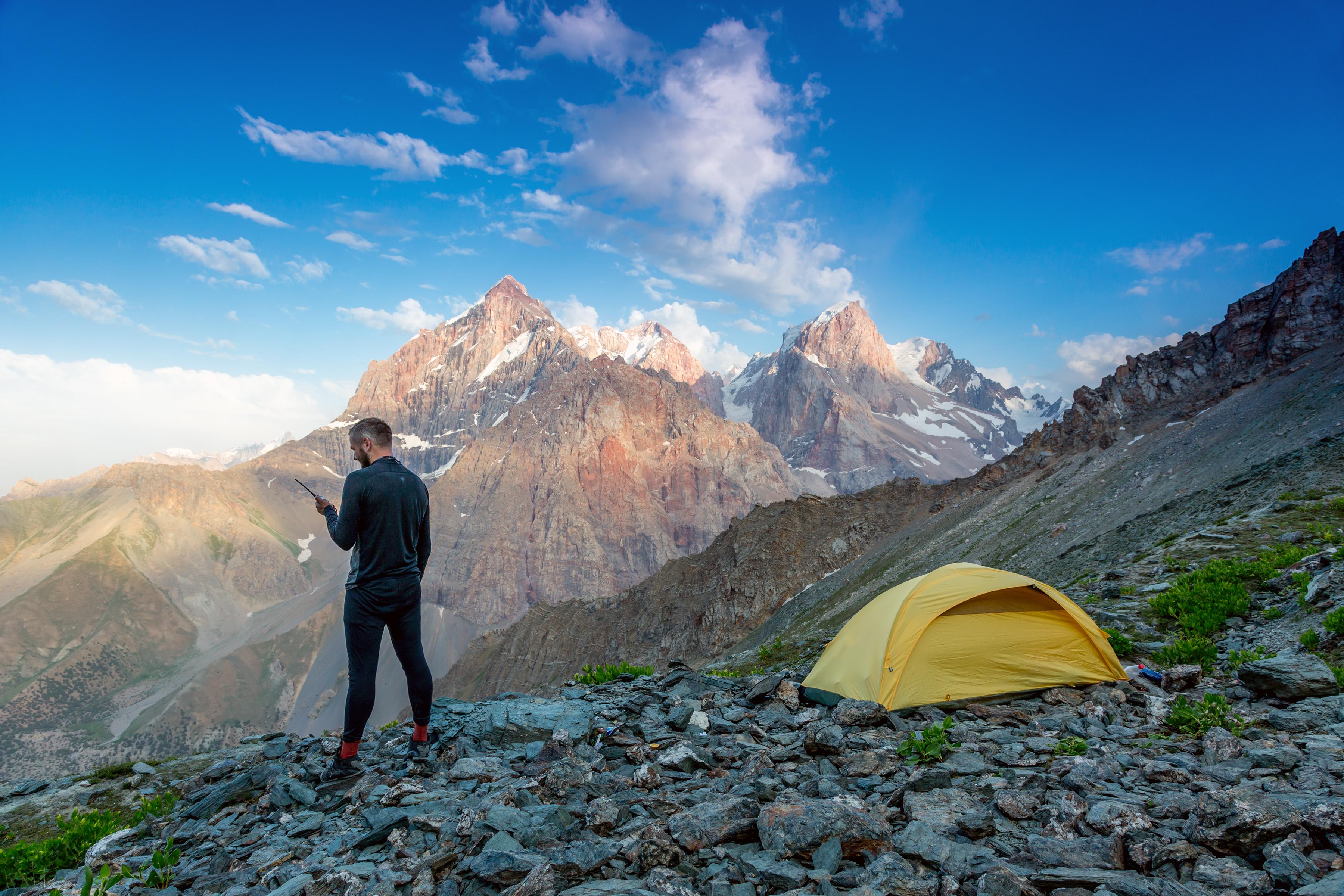 Man camping on mountainside