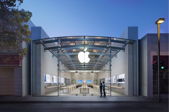 The exterior of an Apple store in the evening