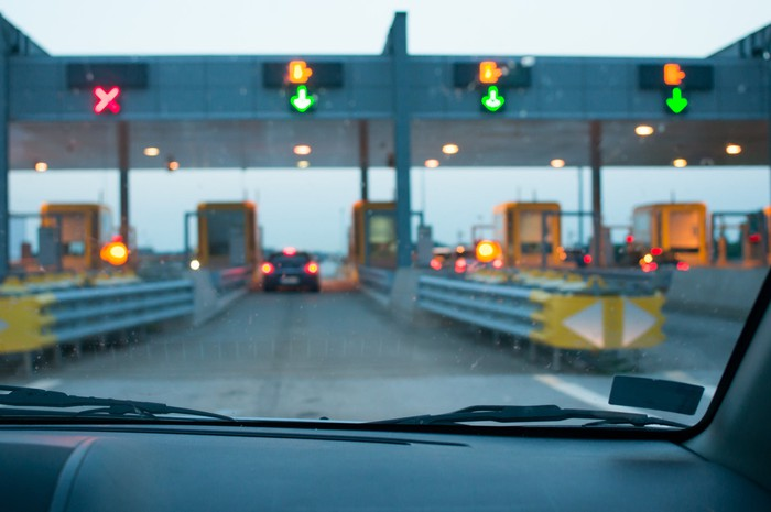 a driver arriving at a toll road booth