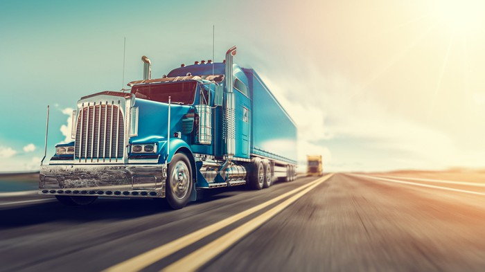 a render image of truck on the road