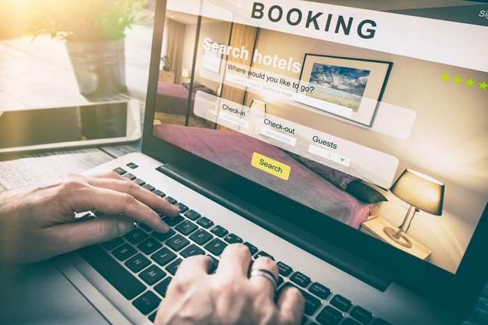A person makes a booking for a hotel room online.