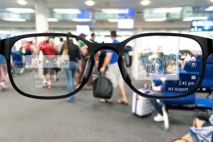 A pair of AR glasses being used at an airport.