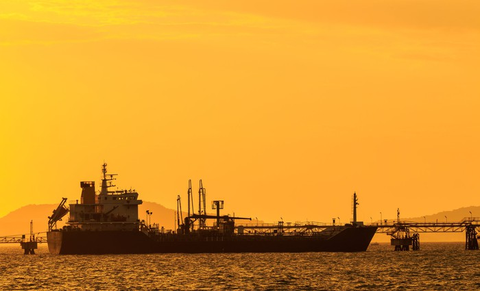 Tanker getting loaded at sunset