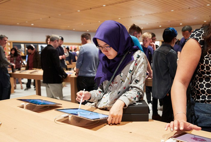 Customer trying iPad Pro at an Apple Store