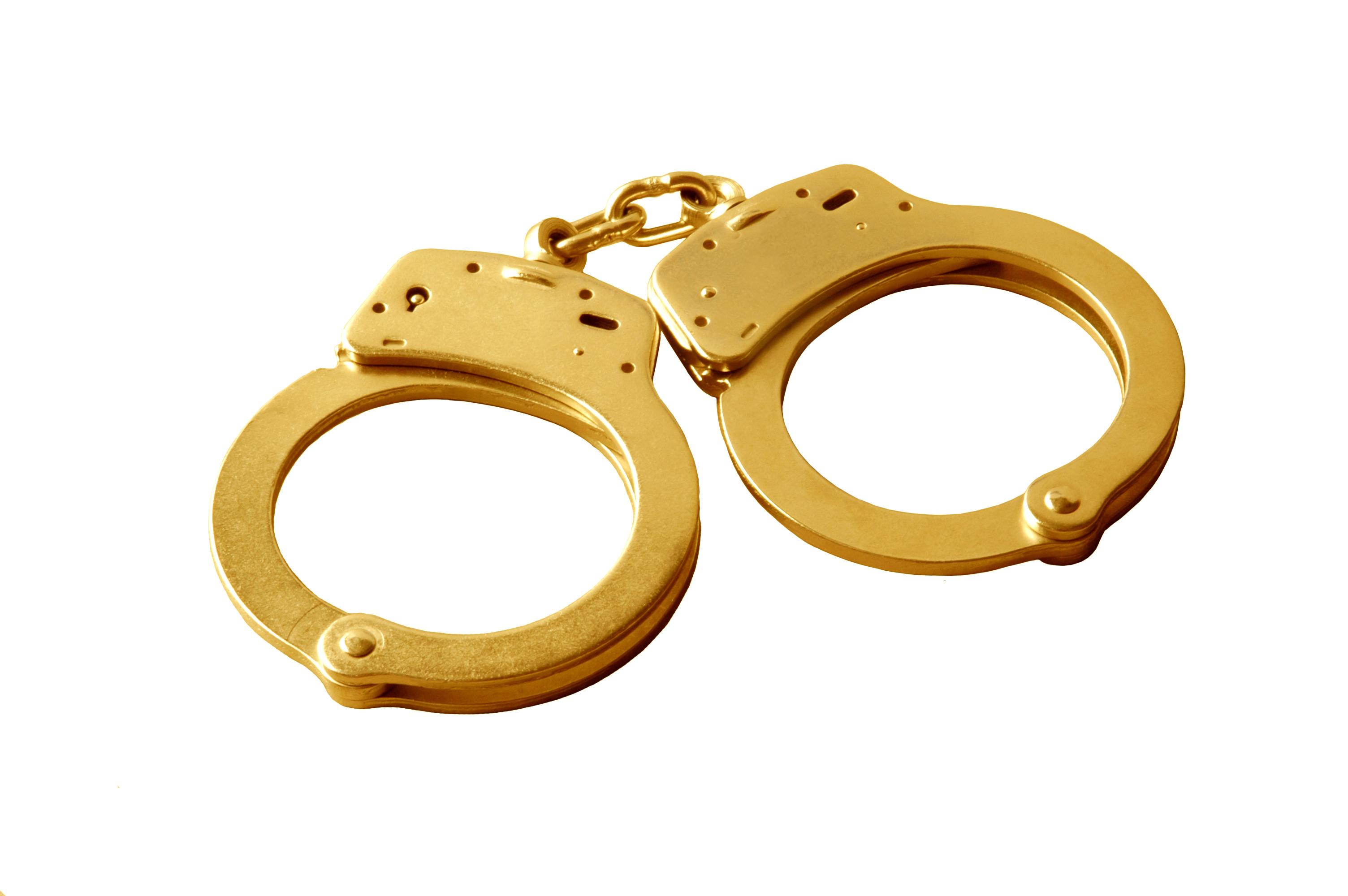 Pair of golden handcuffs