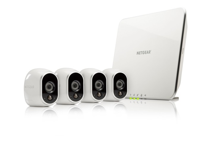Netgear Arlo security cameras and router against a white background.