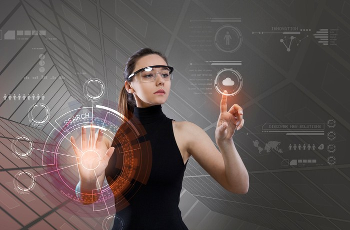 A woman wearing a pair of augmented reality glasses.