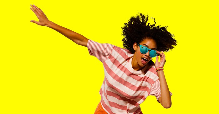 A woman wearing Snap Inc.'s Spectacles.