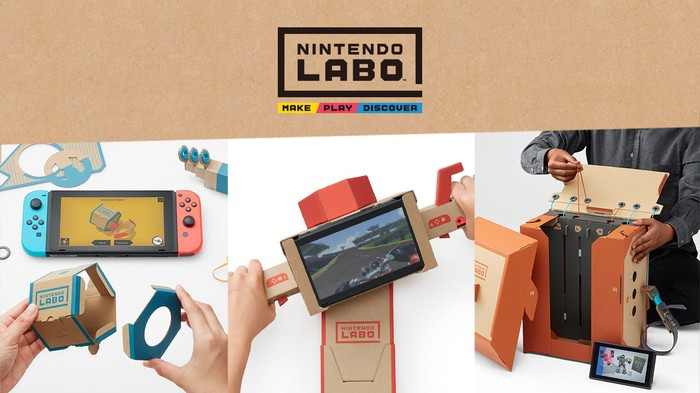 Hands playing with the Switch system and cardboard pieces under the Nintendo product logo.