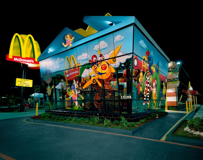 Exterior view of McDonald's Dallas location at night.