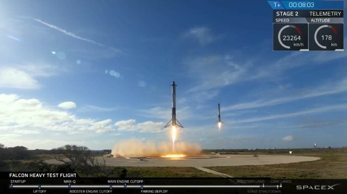 Two SpaceX rockets landing side-by-side