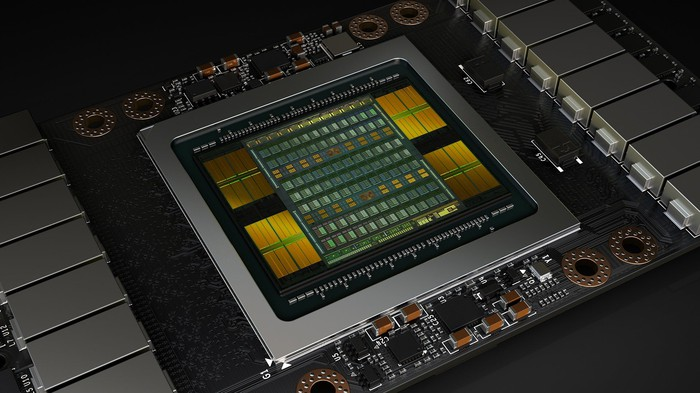 NVIDIA's yellow and green Tesla V100 processor.