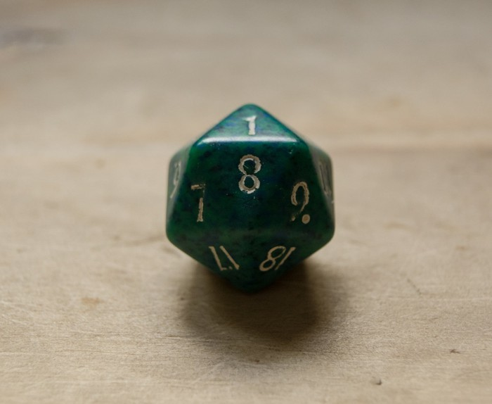 Green twenty sided dice.