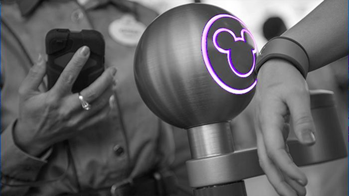 A MagicBand triggering an entrance at Disney World