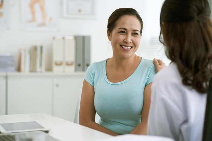 A doctor talking to a patient.