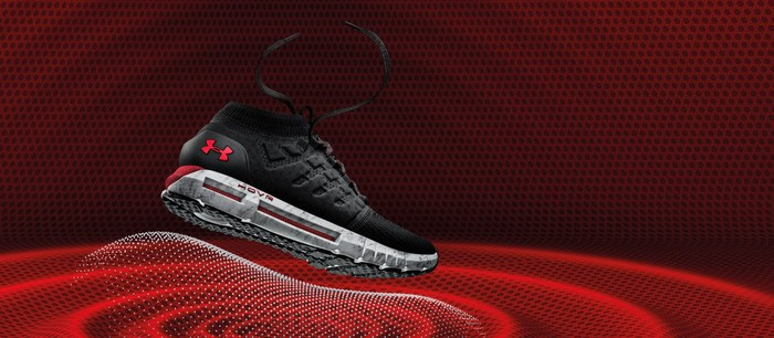 Under Armour's Hovr running shoe against a red background
