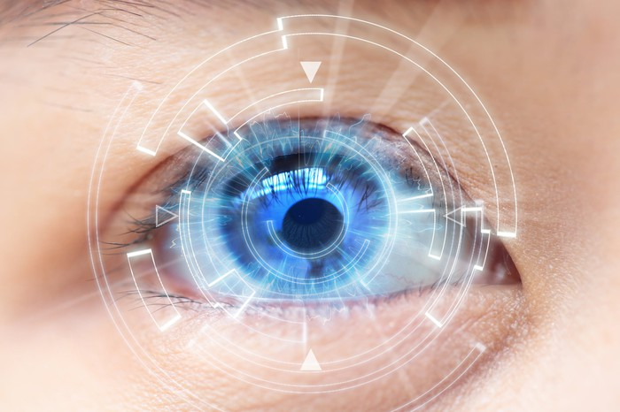 Closeup of eye with superimposed computer image