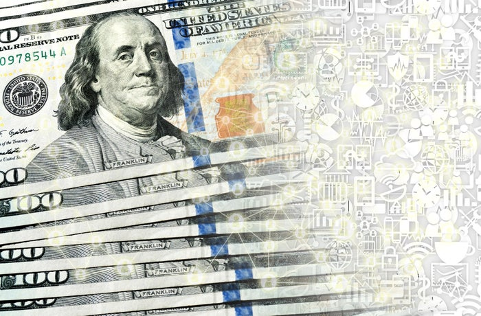 A stack of hundred dollar bills being transformed into digital currency.