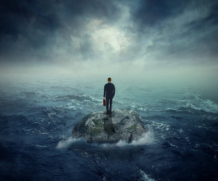 a man standing on an island in the middle of a raging storm