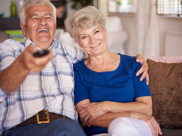 senior couple watching tv_GettyImages-484143734