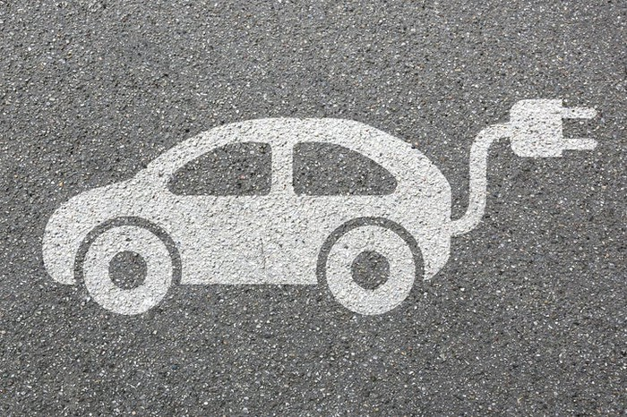 An electric car drawn in chalk on the sidewalk.
