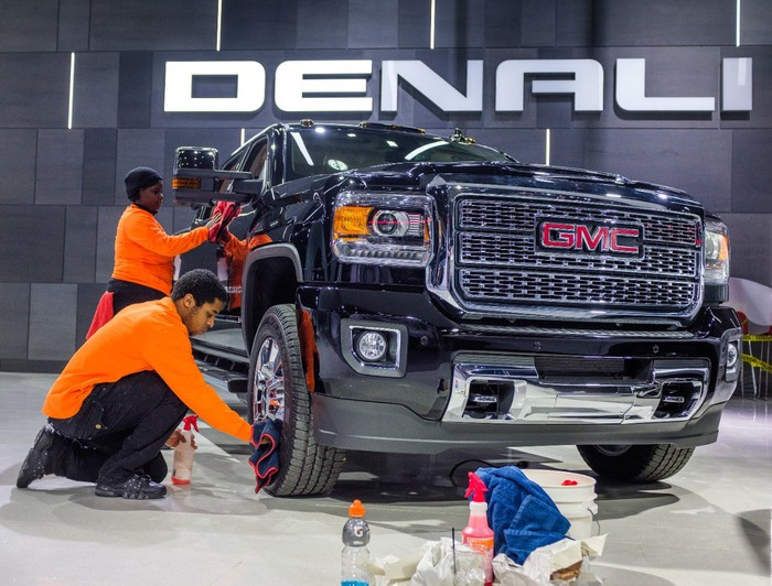 A GMC truck being detailed for a show.