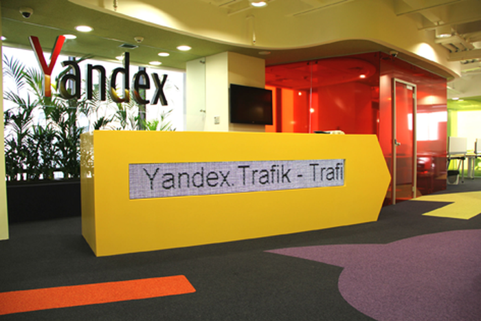 Yandex office front desk with company logo in the background