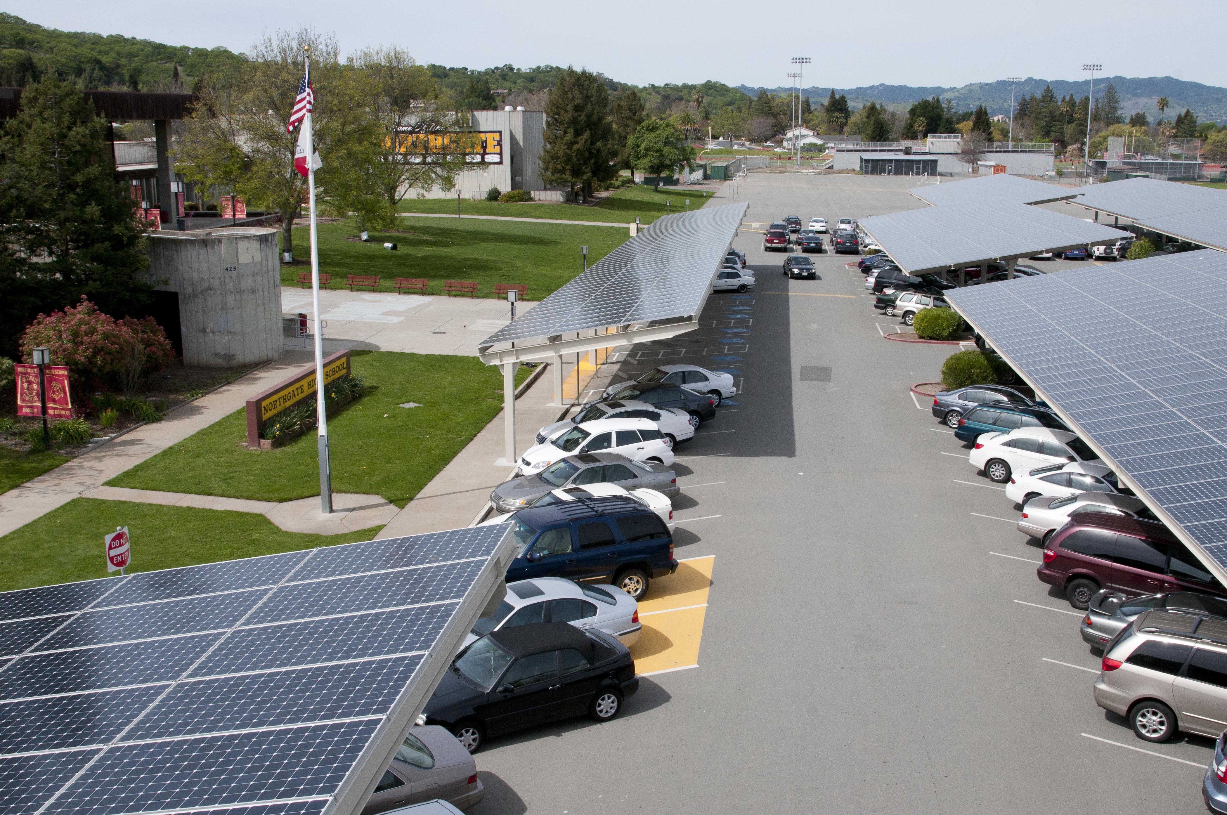 Solar carport with cars under it.
