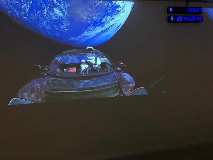 Tesla Roadster in orbit, with a spacesuit in the driver's seat