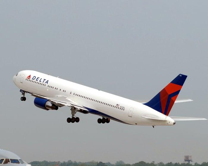 A Delta Air Lines 767-400ER jet taking off