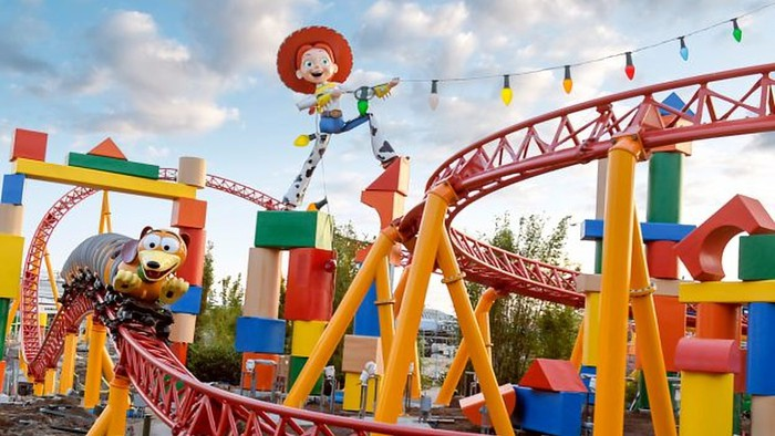 Slinky Dog Dash with  Jessie the Yodeling Cowgirl at Disney's Hollywood Studios under blue skies