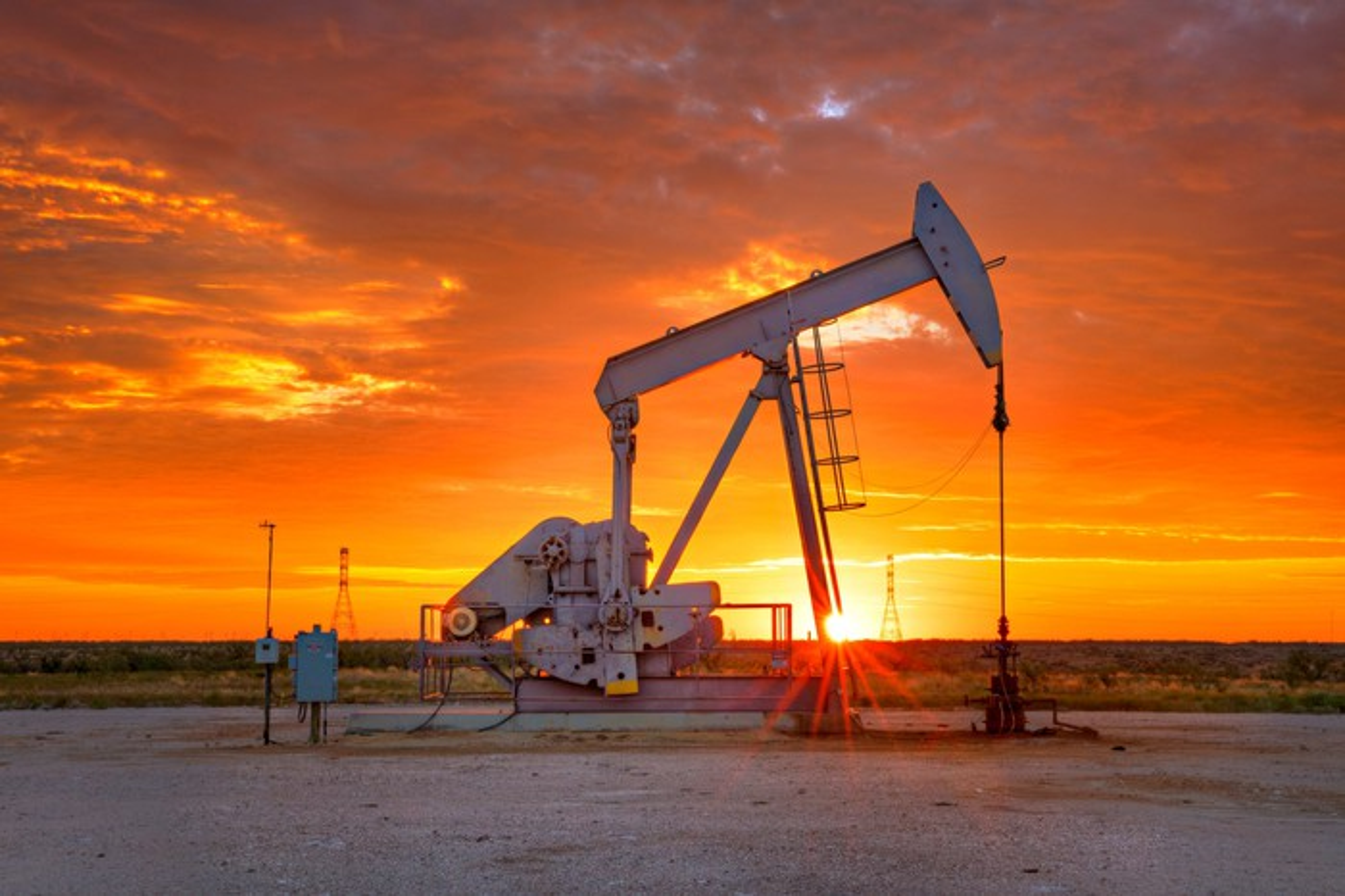 Oil pump during a beautiful golden sunrise.