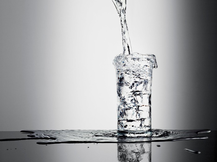 An overflowing cup of water