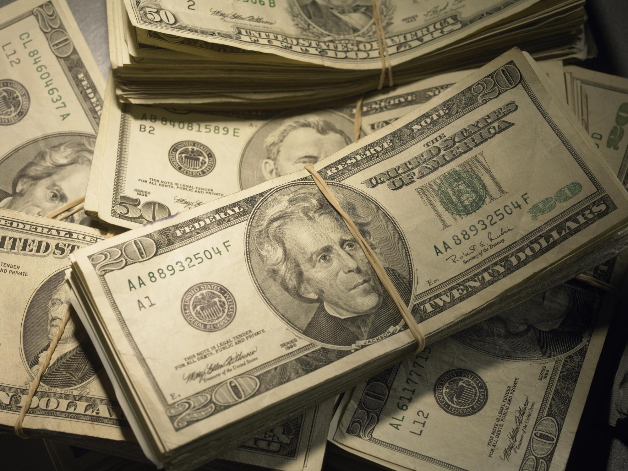 Stacks of $20 and $50 bills.